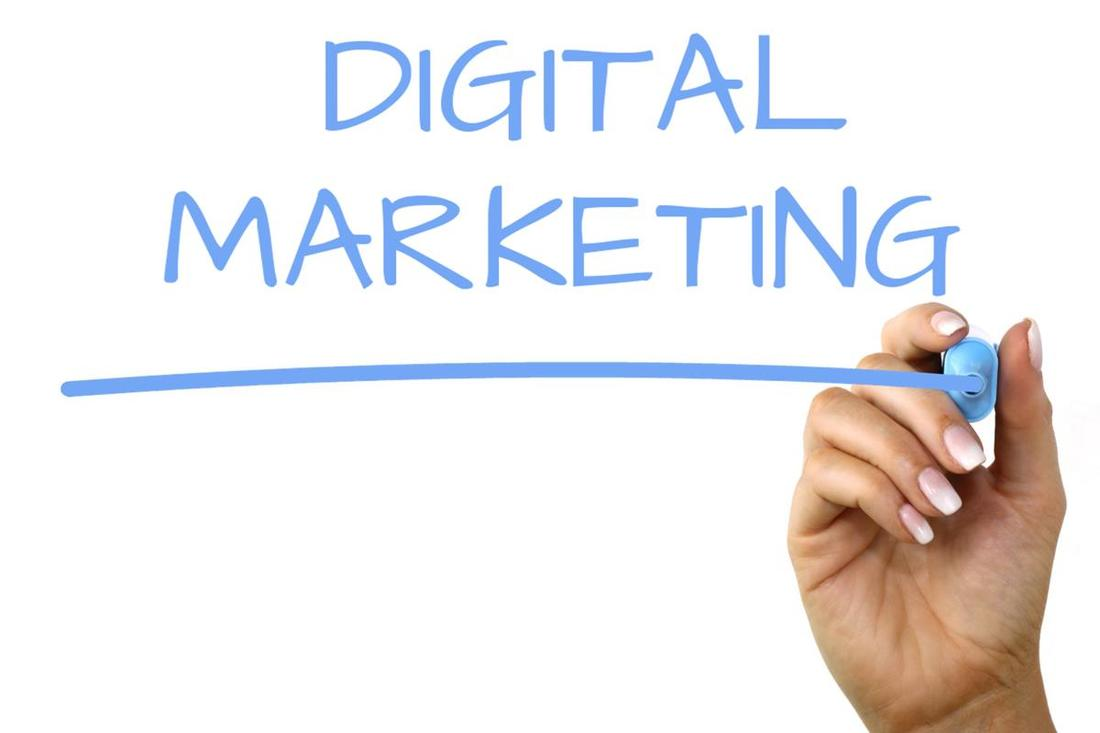 The words Digital Marketing written in marker on a clear background